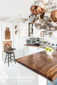I am really loving the look of butcher block counters, especially with my white cabinetry.