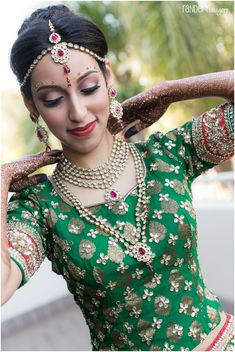 Traditional Indian bride wearing bridal makeup, jewellery and lehenga