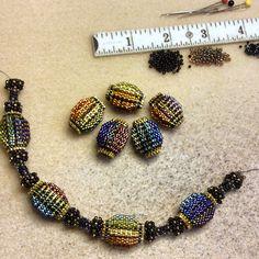 Almost halfway on #rainbow melon bead necklace #beadedjewelry #funwithbeads #beadedbead #beadwork