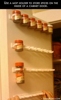 Use mop holder to organize spices.