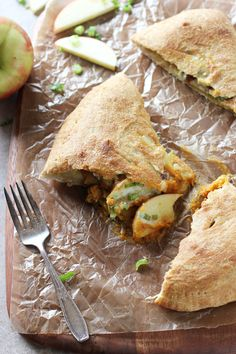 Recipe for pumpkin, apple and cheddar calzones. Sweet and savory. With pumpkin puree, fresh sage, apples and white cheddar! So fun for fall!
