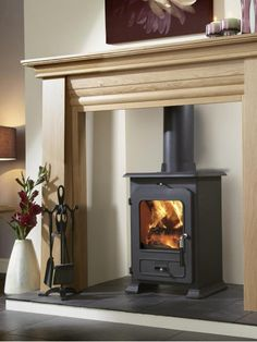 hearths on dark wood floors for wood burning stoves - Google Search