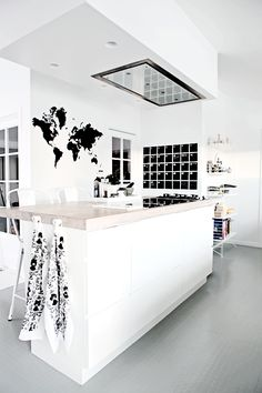 love this kitchen; simple combination of pale wood and white with grey rubber floor and touches of black