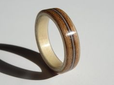 Cherry and Sycamore Bent Wood Ring with a guitar string inlay by ZebranoWoodCraft