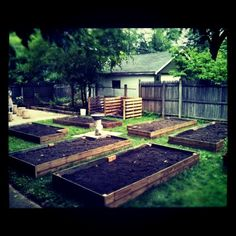 Raised beds, compost heap, and pebbled area. From -ce.