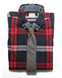 Gray wool tie with plaid turns the tie into a more casual but still sophisticated accessory.