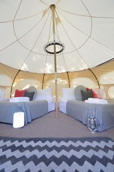 VIP 5 meter Lotus Belle Tent. Couples layout with two king size beds.