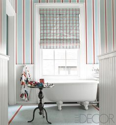 A traditional footed tub is offset by custom painted walls that are both soothing and playful. Look to bold vertical stripes to create the appearance of height and enhance the drama of your space.