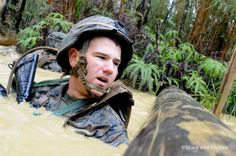 A Marine with Company I, 3rd Battalion, 1st #Marines prepares to swim under an obstacle at the Jungle Warfare Training Center at Camp Gonsalves, #Okinawa, Feb. 12, 2014. (LISA TOURTELOT/STARS AND STRIPES) #Japan #military #USMC @U.S. Marines