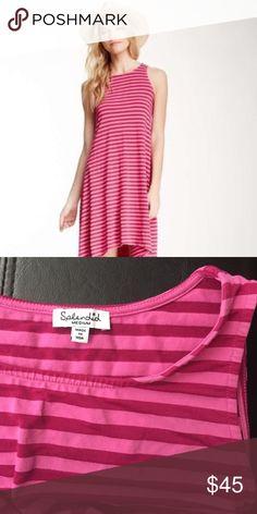 New Splendid striped Hi Lo sleeveless dress medium This is new Splendid Hi Lo striped dress. It is sleeveless. Size medium. Made of tencel/cotton/Lycra. Hangs perfectly. Colors pink and fuschia. Splendid Dresses High Low