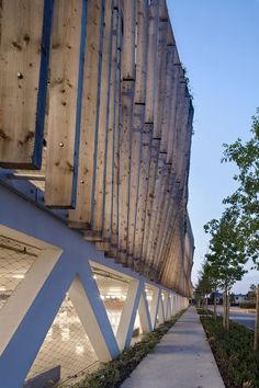 Weathered timber baffles.  Parking in Soissons / Jacques Ferrier Architectures