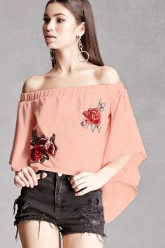 A woven off-the-shoulder top featuring a semi-cropped silhouette, elasticized neckline, embroidered floral appliques on the front, short angel sleeves, and a crossover tulip back hem. This is an independent brand and not a Forever 21 branded item.
