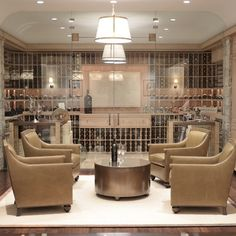 Giannetti Home: Chic basement wine cellar with seamless glass doors and exposed brick walls. Wine cellar ...