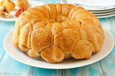 Pepperoni Pizza Monkey Bread - each piece has a pepperoni and a cube of mozzerella cheese inside! *I rolled each piece in a lot of garlic butter before with a little parmesan cheese before putting it in the pan... So YUMMY!