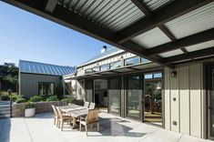 Arroyo Grande Farmhouse Gast Architects Like the patio cover from wood and corrugated steel.