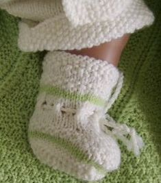 My long awaited baby doll Christina and her  lovely new clothes knitted in soft wool yarn. Design: Målfrid Gausel
