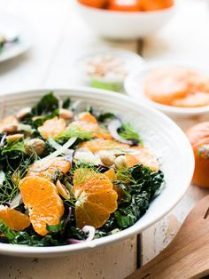 #ad Mandarin Orange Kale Salad with Mandarin Vinaigrette is the lightness we crave in the depths of winter. Each bite bursts with juicy Wonderful Halos #mandarins, crunchy #kale, #fennel and #almonds dressed in a #citrus dressing -- you will love how this simple and refreshing #salad brings balance to the table! Sponsored by @HalosFun. #HalosGCC #WonderfulHalos #GoodChoiceKid