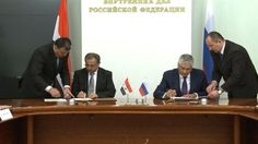 Russian Interior Minister Vladimir Kolokoltsev (R) and his Syrian counterpart Mohammad Ibrahim al-Shaar sign an anti-terrorism deal in the Russian capital, Moscow, April 27, 2015.