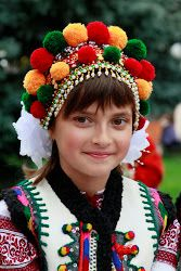 Ukrainian (Hutsul) girl in traditional costume.  Note the beautiful embroidered vest.