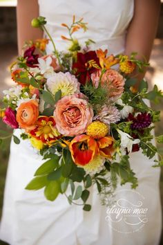 Stunning bridal bouquet - with peach, orange, yellow, red and crimson dahlias, roses, ranunculas, tulips