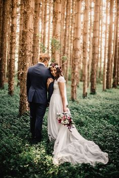 Amazing woodland boho wedding with bride wearing Grace Loves Lace dress and flower crown | Emily Stone Fine Art Portraiture | See more: http://theweddingplaybook.com/vibrant-heartfelt-bohemian-wedding/