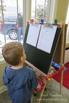 Children signing their names when they come to school
