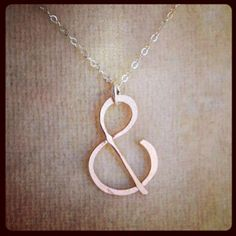 ampersand rose gold, yellow gold, and  sterling silver necklace. $33.00, via Etsy.