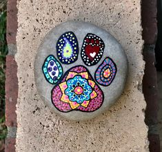 Dog Paw Print Hand Painted Mandala Rock by JustNaturalElements on Etsy Mandala Painted Rocks, Painted Rocks Kids, Mandala Rocks, Painted Stones, Rock Painting Ideas Easy, Rock Painting Designs, Pet Memorial Stones, Dog Paintings, Rock Crafts