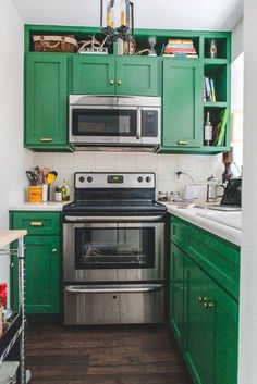 Very Small Kitchen With Green Painted Cabinets And Stainless Steel Appliances