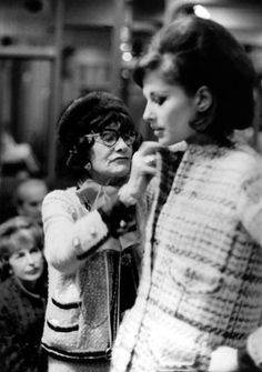 Coco Chanel fitting a tweed suit ~ It's been 43 yrs. since Coco Chanel's death and she worked up until the very end at age 87.
