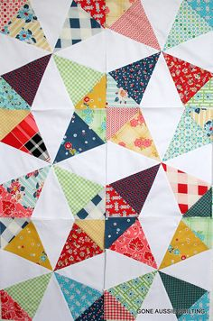 Love those scrappy quilts!
