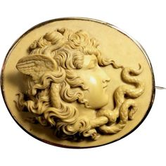 Material: Lava,  15 k Gold tested. Size: 2 1/8 by 1 7/8. Date and Origin: circa 1860 Italy. Conditions: Conditions Excellent. No chips or cracks or