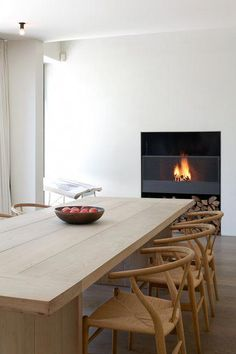 fireplace and light natural wood for a modern dining room