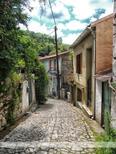Cobblestone road in Agiasos village by Stratis Axiotis, Lesvos island, northeast Aegean sea, Greece Old Greek, Miles To Go, Greek Islands, Small Towns, Tuscany, Paths, Cool Pictures, Greece, Spain