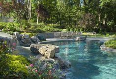 Backyard pool with waterfall