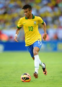 Neymar Jr playing in his Brazil national team jersey.