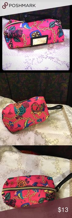 Betsey Johnson Makeup Bag Medium SZ ~EUC~ This is a pre-loved and in excellent used condition. Betsey Johnson medium size makeup bag. Zipper closure. Faux patent black leather strap. Gold hardware and a lot of room in this bag.  please feel free to ask any questions Betsey Johnson Bags Cosmetic Bags & Cases