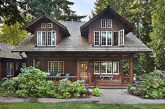An historic log home renovated by Janof Architecture is located in Beaux Arts Village, a town located in the Eastside of Seattle, Washington.
