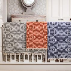 Patio rug or mat for indoors or outdoors. Geometric woven design in three colourways. From recycled plastics, easy to wash. Fair Trade.