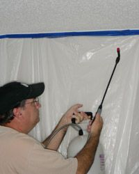Remove popcorn ceiling using a sprayer mixed with dishwashing soap and warm water