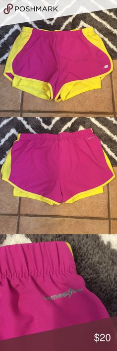 New Balance Shorts Great New Balance shorts for summer. Only worn a few times - very good condition. Pretty yellow and pink in color. Size medium. New Balance Shorts