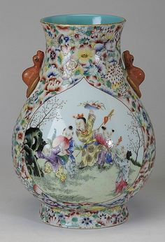 """Chinese famille rose porcelain hu vase with fu bat handles, the body enamel decorated with a central cartouche on each side depicting young boys at play, encircled by a millefleur motif, the underside with a blue underglaze Daoguang seal mark, 13""""h x 9"""" diameter."""