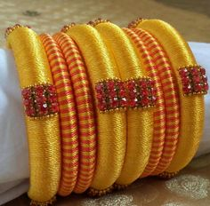Yellow with Red Color Heavy Stone work silk thread bangles Its purely handmade products. Whole sellers are also welcome. Its available in all sizes and Silk Thread Jumkas, Silk Thread Bangles Design, Silk Bangles, Silk Thread Earrings, Bridal Bangles, Thread Jewellery, Thread Work, Diy Jewellery, Jewellery Making