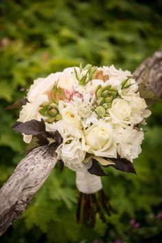 Swooning over this rose bouquet. | See more of this Scottish themed #wedding here: http://www.mywedding.com/articles/lee-and-brittanys-scottish-themed-buskirk-ny-wedding-by-rob-spring-photography/