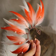 """The Goddess Of The Sun"" Feather Ear Cuff Pink Feather Ear Cuff Pink... ($46) ❤ liked on Polyvore featuring jewelry, feather ear cuff, tribal jewellery, tribal jewelry, tribal ear cuff and ear cuff jewelry"