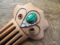 A guest post by a #woodworking jeweler who explains #howto make a wood comb and decorate it with #gems .Very interesting technique!