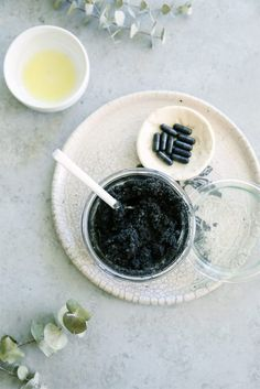 Just mix 1/3 cup cane sugar, 2 capsules of activated charcoal (opened), and 2 tsp Olive oil. You may also add an essential oil of your choice into the mixture.