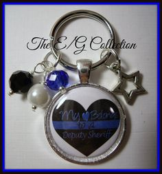 Half of my heart belongs to a Deputy Sheriff... the other half belongs to my precious daughter. Love my kids! - keyring by TheEandGCollection