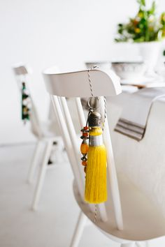 hang moroccan tassels from guest's chairs for a simple gift | moroccan tabletop by coco kelley
