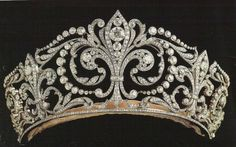 The Fleur de Lys Tiara of Spain. Description: Made by Ansorena in the diamond and platinum tiara features the Fleur de Lys, the heraldic emblem of the House of Bourbon (Borbón). The Fleur de Lys was given by King Alfonso XIII to his bride,. Royal Crown Jewels, Royal Crowns, Royal Tiaras, Royal Jewelry, Tiaras And Crowns, Vintage Jewelry, Fine Jewelry, Pageant Crowns, Head Jewelry